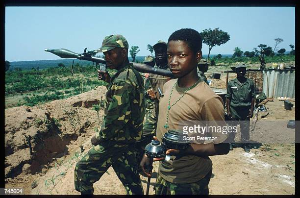 A government soldier displays a land mine October 25 1993 in Menogue Angola Angolan rebels have continued the civil war after losing elections on...