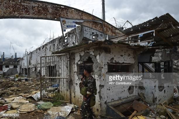 A government soldier stands at the entrance of the bombedout city police headquarters in what was the main battle area in Marawi on the southern...