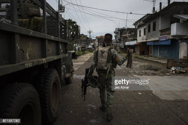 Government soldiers prepare for deployment to the main battle area on July 22 2017 in Marawi southern Philippines The Philippine Congress voted on...