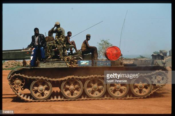 Government soldiers ride atop an armored vehicle October 25 1993 in Menogue Angola Angolan rebels have continued the civil war after losing elections...