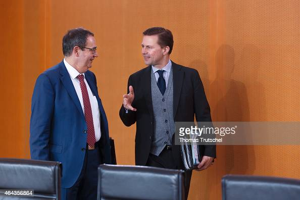 Government spokespersons Georg Streiter and Steffen Seibert arrives for the weekly cabinet meeting at the chancellery on February 25 2015 in Berlin...