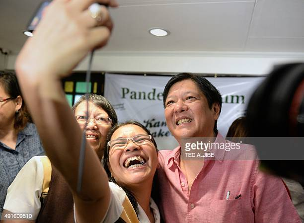 Government teachers take a 'selfie' with Philippine Senator Ferdinand 'Bongbong' Marcos Jnr the son of late Philippine dictator Ferdinand Marcos...