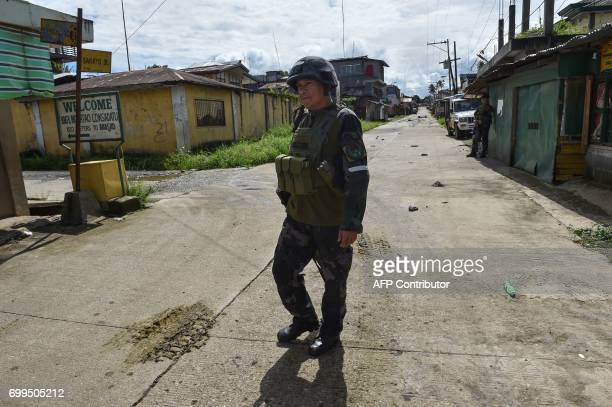 A government trooper walks on a deserted street near the frontline in Marawi on the southern island of Mindanao on June 22 as fighting between...