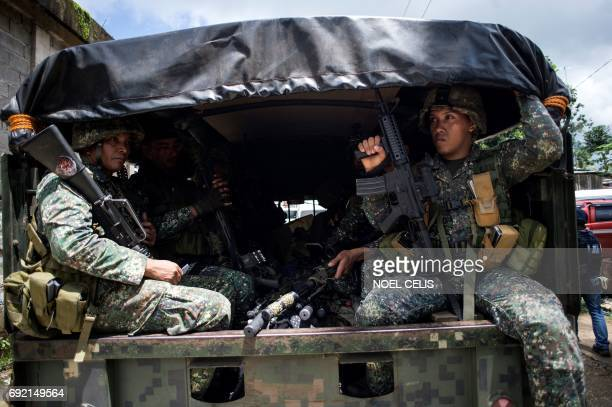 Government troops aboard their truck arrive to reinforce their colleagues in Marawi on the southern island of Mindanao on June 4 2017 Efforts to...