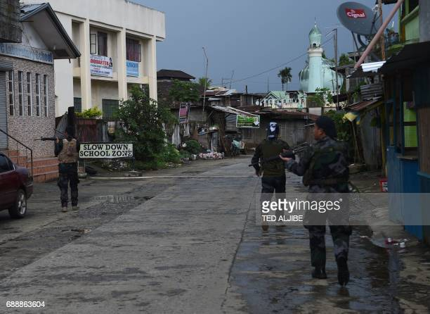 Government troops patrol a deserted street near the position of Islamic militantst as government planes and helicopters bombed militants position in...