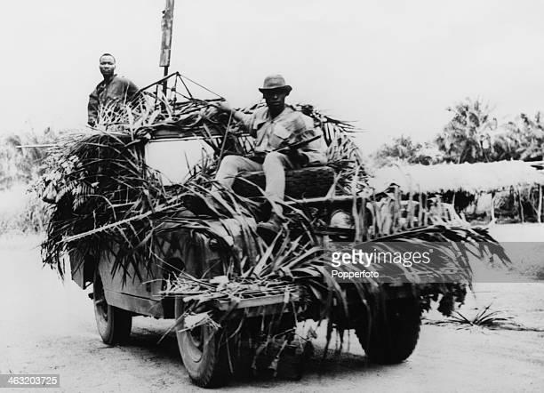 Government troops riding on a camouflaged Land Rover in a search for rebel troops of the breakaway region of Biafra during the Nigerian Civil War...