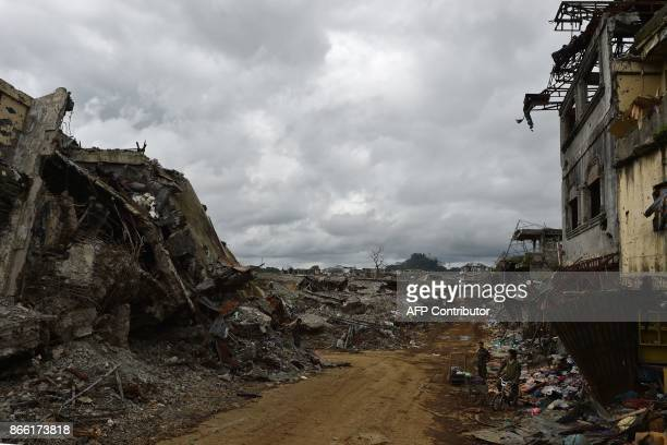 Government troops stand amongst bombedout buildings and a flattened public market in what was the main battle area in Marawi on the southern island...