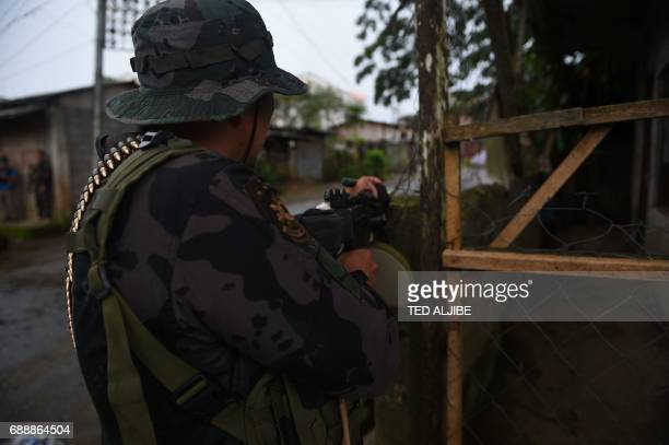 A government troops take position from sniper fire from Muslim militants near a hospital in Marawi in southern island of Mindanao on May 27 2017 The...