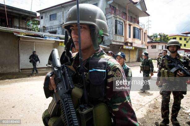 Government troops walk inside of a NO GO ZONE to search for explosives and firearms left be Islamic rebels in Marawi City in Southern Philippines...