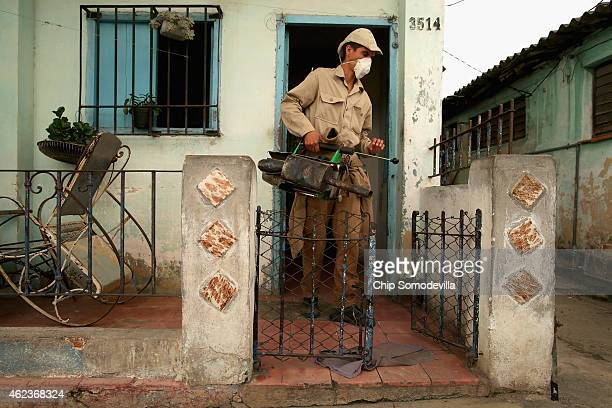 A government worker uses a fuelpowered pump to spray for mosquitos as part of an antiDengue fever campaign in the Marianao District January 27 2015...