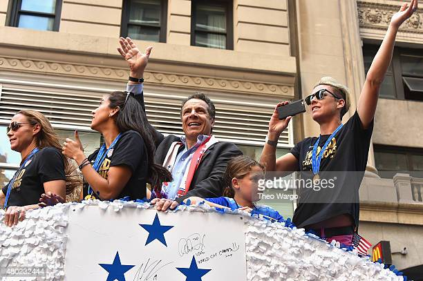 Governor Andrew Cuomo and Abby Wambach during New York City Holds Ticker Tape Parade For World Cup Champions US Women's Soccer National Team on July...