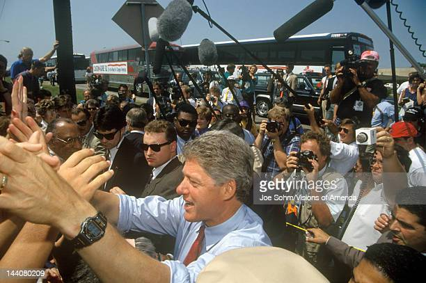 Governor Bill Clinton shakes hands at an unscheduled bus stop on the Clinton/Gore 1992 Buscapade campaign tour in Texas