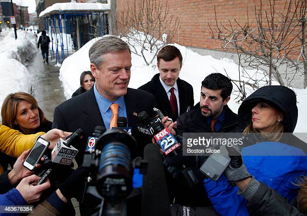Governor Charlie Baker is surrounded by media as he leaves an MBTA meeting with Beverly Scott in Boston Massachusetts February 12 2015