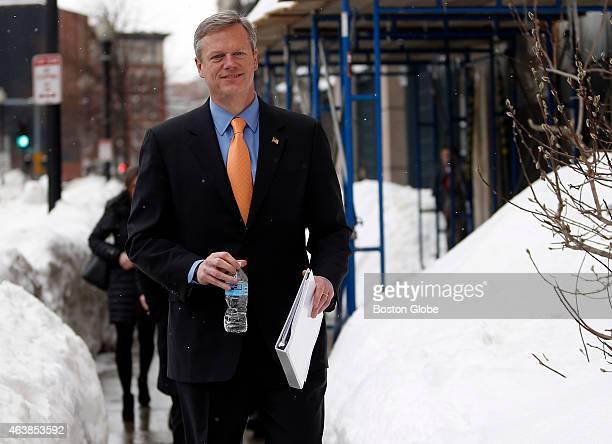 Governor Charlie Baker leaves an MBTA meeting with Beverly Scott in Boston Massachusetts February 12 2015