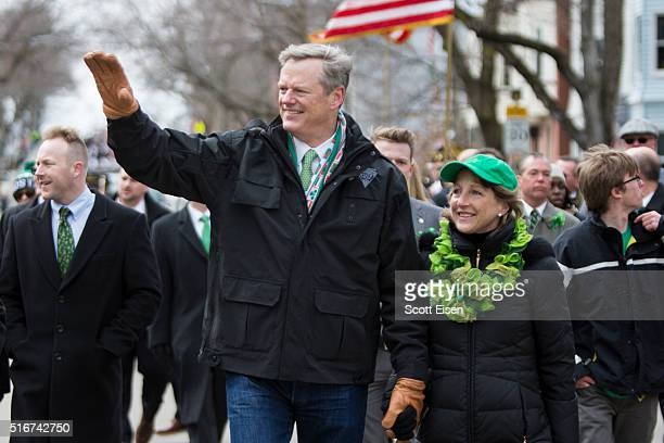 Governor Charlie Baker of Massachusetts and wife Lauren Baker march in the annual South Boston St Patrick's Parade passes on March 20 2016 in Boston...