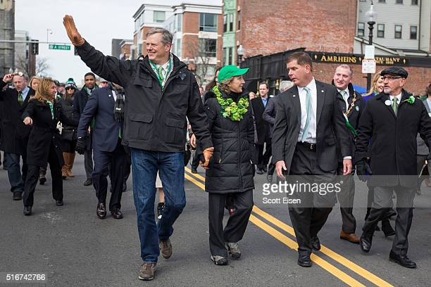 Governor Charlie Baker of Massachusetts and wife Lauren Baker march with Boston Mayor Martin Walsh during the annual South Boston St Patrick's Parade...