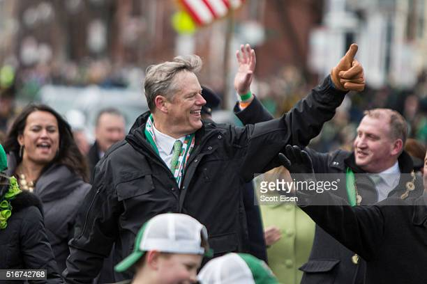 Governor Charlie Baker of Massachusetts gives the thumbs up while he marches in the annual South Boston St Patrick's Parade passes on March 20 2016...