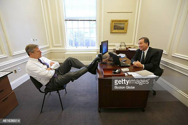 Governor Charlie Baker settles in for his second day of work at the State House on January 12 2015 He chats in the office of his Chief of Staff Steve...