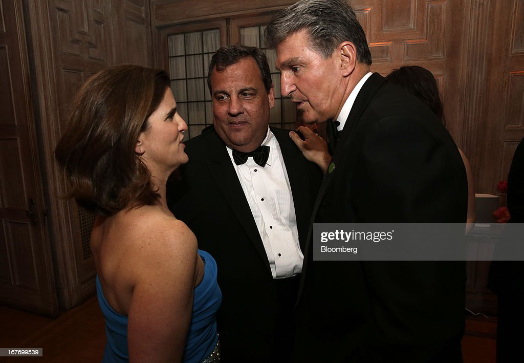 Governor Chris Christie, a Republican from New Jersey, center, and guests attend the Bloomberg Vanity Fair White House Correspondents' Association (WHCA) dinner afterparty in Washington, D.C., U.S., on Saturday, April 27, 2013. The 99th annual dinner raises money for WHCA scholarships and honors the recipients of the organization's journalism awards. Photographer: Scott Eells/Bloomberg via Getty Images