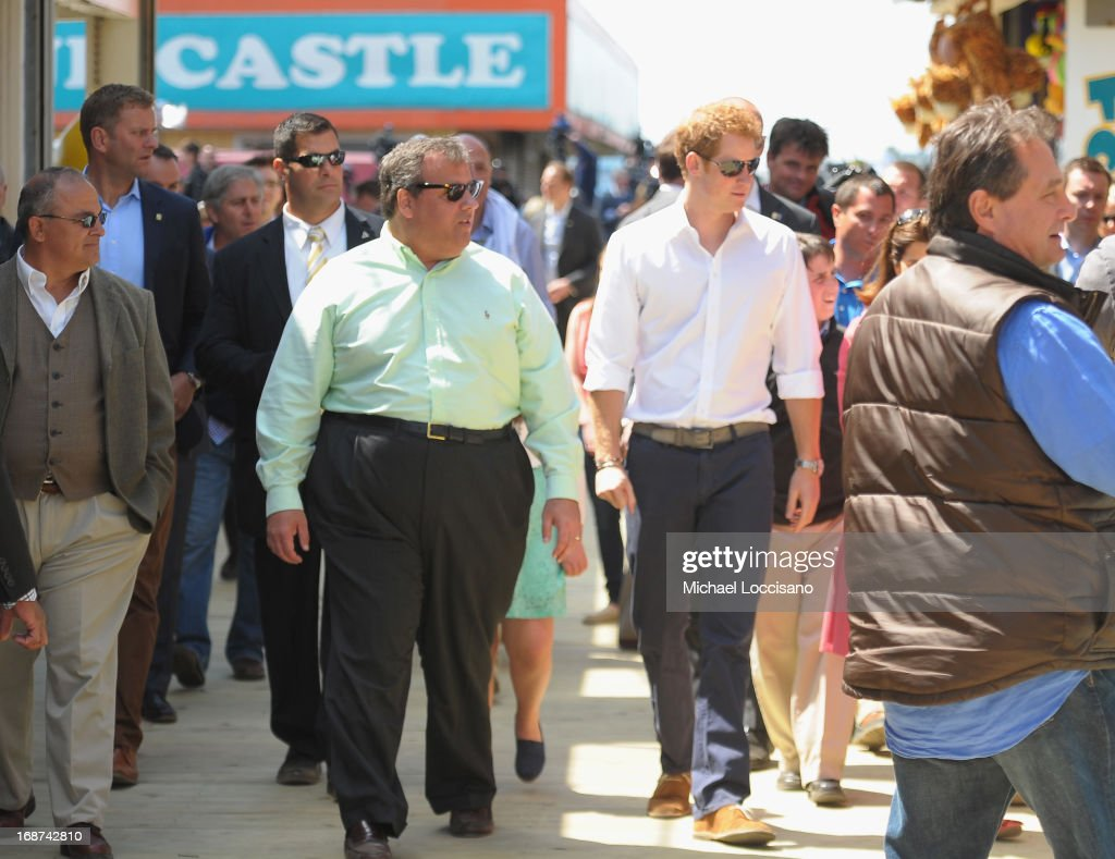 Governor <a gi-track='captionPersonalityLinkClicked' href=/galleries/search?phrase=Chris+Christie&family=editorial&specificpeople=6480114 ng-click='$event.stopPropagation()'>Chris Christie</a> (L) and HRH <a gi-track='captionPersonalityLinkClicked' href=/galleries/search?phrase=Prince+Harry&family=editorial&specificpeople=178173 ng-click='$event.stopPropagation()'>Prince Harry</a> tour the Superstorm Sandy ravaged boardwalk during the fifth day of Harry's visit to the United States on May 14, 2013 in Seaside Heights, New Jersey. HRH will be undertaking engagements on behalf of charities with which the Prince is closely associated on behalf also of HM Government, with a central theme of supporting injured service personnel from the UK and US forces.