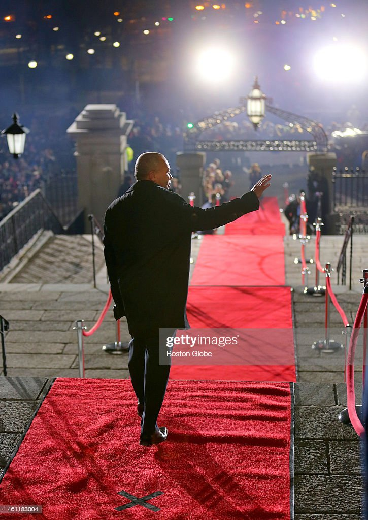 Governor Deval Patrick walks down the red carpet in Doric Hall as he leaves through the front door of the State House during his lone walk and down...