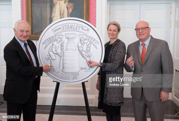 Governor General of Canada David Johnston and Deputy NHL Commissioner Bill Daly pose with the Stanley Cup 125th Anniversary coin during the Stanley...