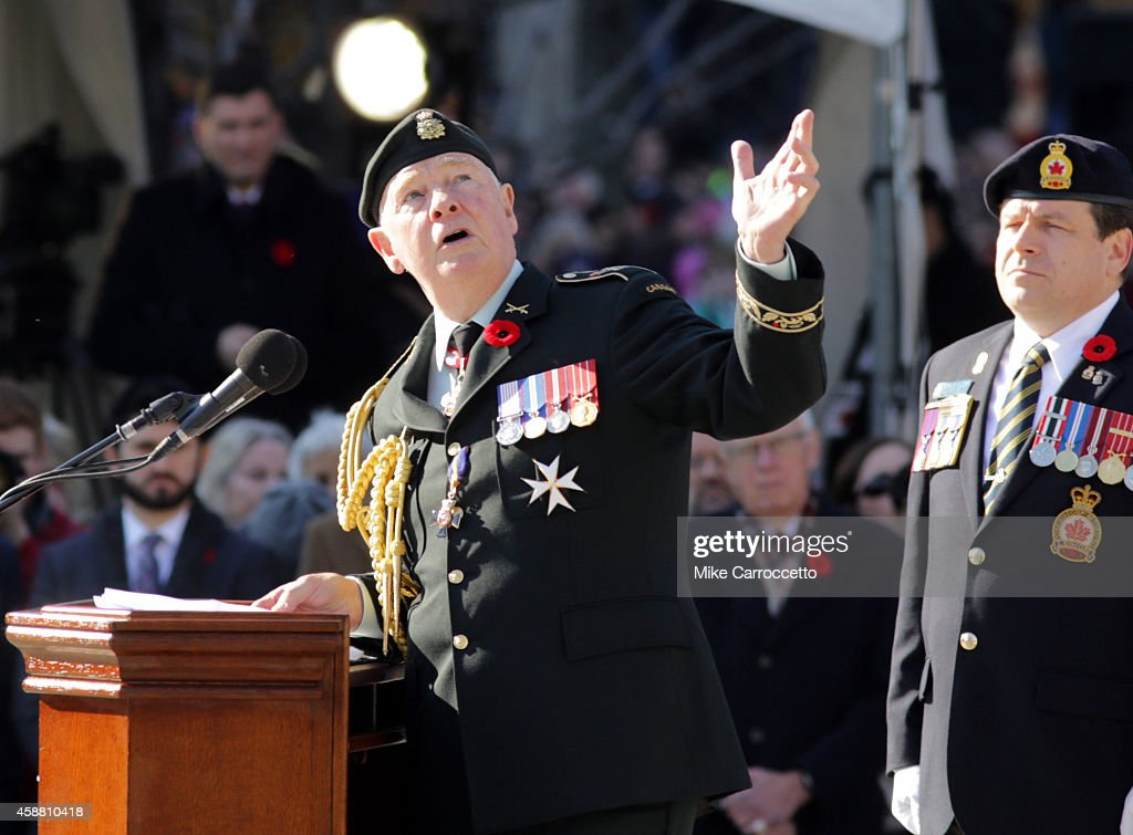 Governor General of Canada <a gi-track='captionPersonalityLinkClicked' href=/galleries/search?phrase=David+Johnston+-+Politician&family=editorial&specificpeople=7915223 ng-click='$event.stopPropagation()'>David Johnston</a> points to the War Memorial Monument as he addresses the crowd during this morning's Remembrance Day ceremony, Tuesday, November 11, 2014 in Ottawa, Canada. An estimated 50,000 or more people lined the streets around the War Memorial Monument to take in the ceremony.