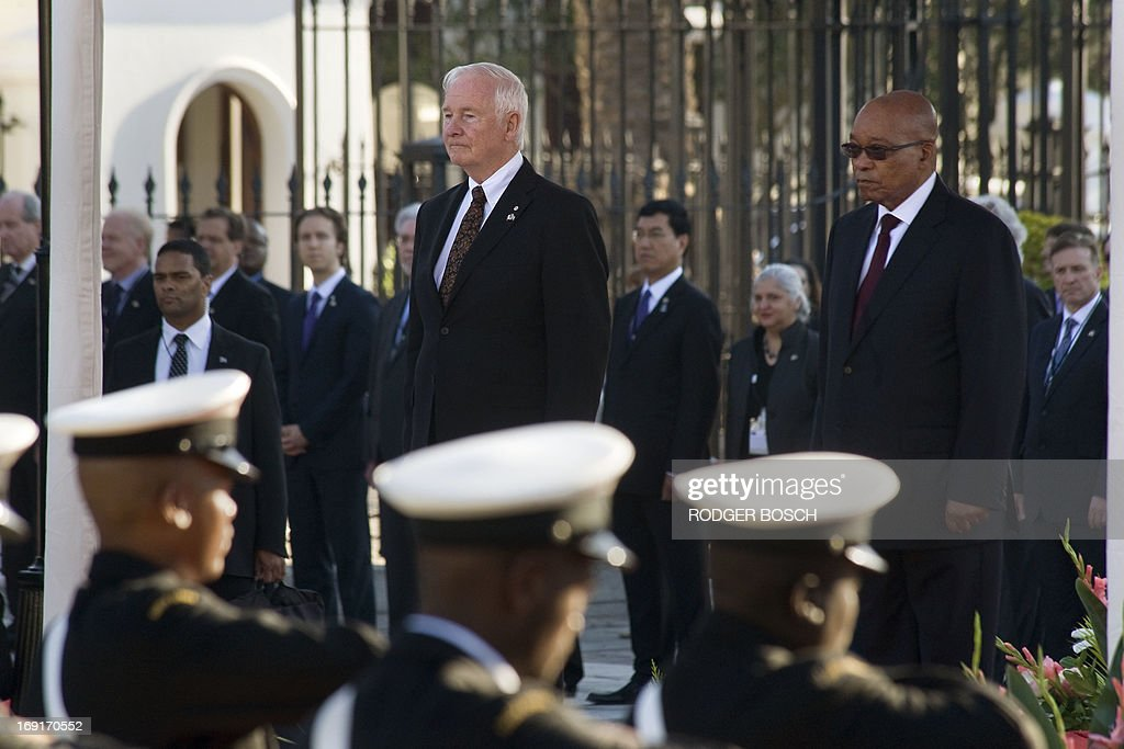 Governor General of Canada David Johnstone (C) stands next to South African president Jacob Zuma as they listen to national anthems, on May 21, 2013 in Cape Town, during Johnstone's state visit to South Africa.