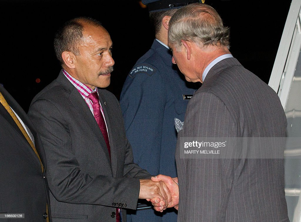 Governor General of New Zealand Lieutenant General Jerry Mateparae (L) shakes hands with Britain's Prince Charles before he departs New Zealand ending the Diamond Jubilee tour in Christchurch on November 16, 2012. The Royal couple are in New Zealand on the last leg of a Diamond Jubilee that takes in Papua New Guinea, Australia and New Zealand. Photo AFP / Marty Melville