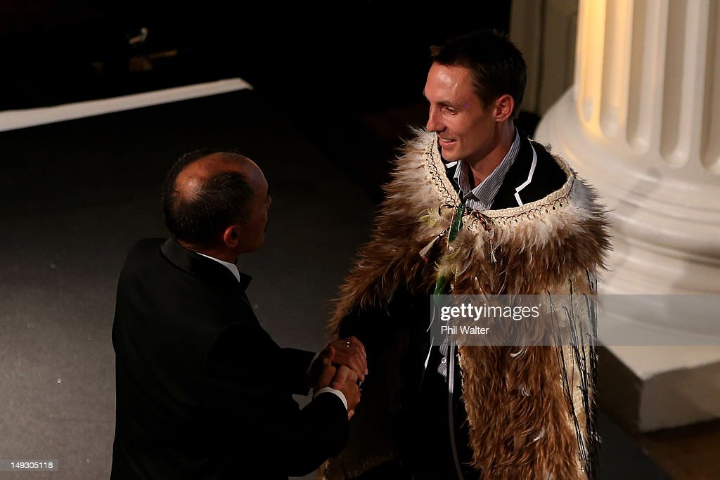 Governor General Sir Jerry Mateparae shakes hands with New Zealand flag bearer Nick Willis of New Zealand during the NZOC Governor General's Gala Dinner ahead of the London 2012 Olympic Games at Banqueting House, Whitehall on July 26, 2012 in London, England.