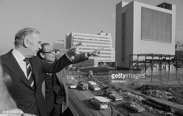 Governor Hugh Carey and architect I M Pei discuss new convention center at the site where it will be built on New York's west side Designs for the 16...
