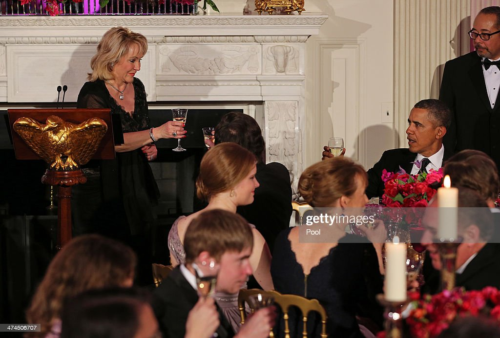 Governor Mary Fallin (R-OK), Chair of the National Governors Association, offers a toast to President <a gi-track='captionPersonalityLinkClicked' href=/galleries/search?phrase=Barack+Obama&family=editorial&specificpeople=203260 ng-click='$event.stopPropagation()'>Barack Obama</a> during the 2014 Governors' Dinner on February 23, 2014 in Washington, DC. President Obama and the first lady hosted the annual event in the State Dining Room of the White House .
