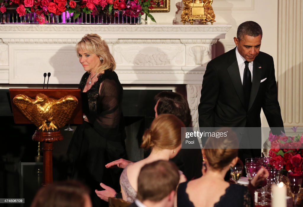 Governor Mary Fallin (R-OK), Chair of the National Governors Association, approaches the lecturn as U.S. President <a gi-track='captionPersonalityLinkClicked' href=/galleries/search?phrase=Barack+Obama&family=editorial&specificpeople=203260 ng-click='$event.stopPropagation()'>Barack Obama</a> takes his seat during the 2014 Governors' Dinner on February 23, 2014 in Washington, DC. President Obama and the first lady hosted the annual event in the State Dining Room of the White House .