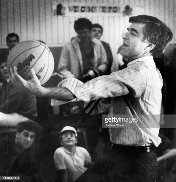 Governor Michael Dukakis shows off his basketball skills after talking to students at Gibbs Junior High School in Arlington Mass on April 12 1987 He...