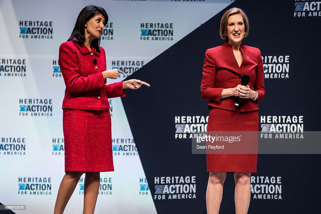 Governor <a gi-track='captionPersonalityLinkClicked' href=/galleries/search?phrase=Nikki+Haley+-+Governatore&family=editorial&specificpeople=6974701 ng-click='$event.stopPropagation()'>Nikki Haley</a> and presidential candidate <a gi-track='captionPersonalityLinkClicked' href=/galleries/search?phrase=Carly+Fiorina&family=editorial&specificpeople=207075 ng-click='$event.stopPropagation()'>Carly Fiorina</a> speak to voters at the Heritage Action Presidential Candidate Forum September 18, 2015 in Greenville, South Carolina. Ten republican candidates were each given 25 minutes to talk to the crowd at the Bons Secours Wellness Arena in the upstate of South Carolina.