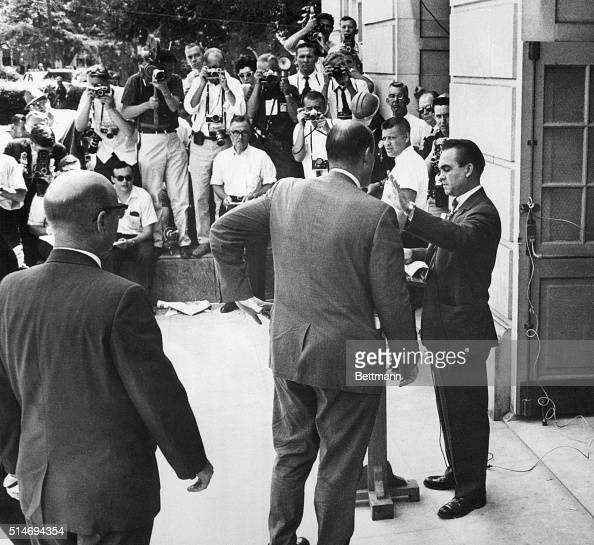 Governor of Alabama George Wallace hold up his hand to Deputy US Attorney Nicholas Katzenbach as he bars entrance to two African American students to...