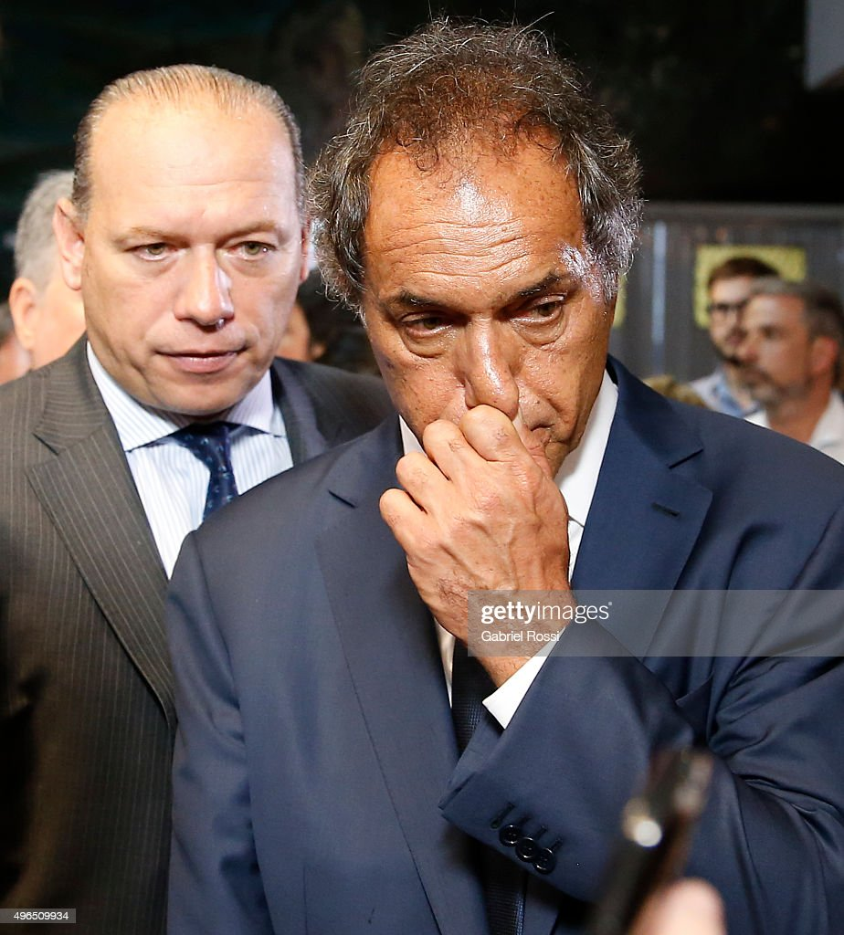 Governor of Buenos Aires and presidential candidate <a gi-track='captionPersonalityLinkClicked' href=/galleries/search?phrase=Daniel+Scioli&family=editorial&specificpeople=616127 ng-click='$event.stopPropagation()'>Daniel Scioli</a> and Security Secretary of Argentina Sergio Berni are seen during campaign rally at Federal Police School Juan Angel Pirker on November 10, 2015 in Buenos Aires, Argentina.