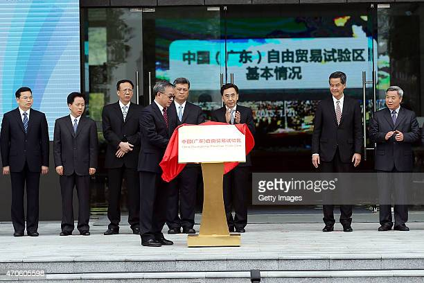 Governor of Guangdong Province Zhu Xiaodan Hu Chunhua secretary of the CPC Guangdong Provincial Committee and Leung Chun Ying Chief Executive of the...
