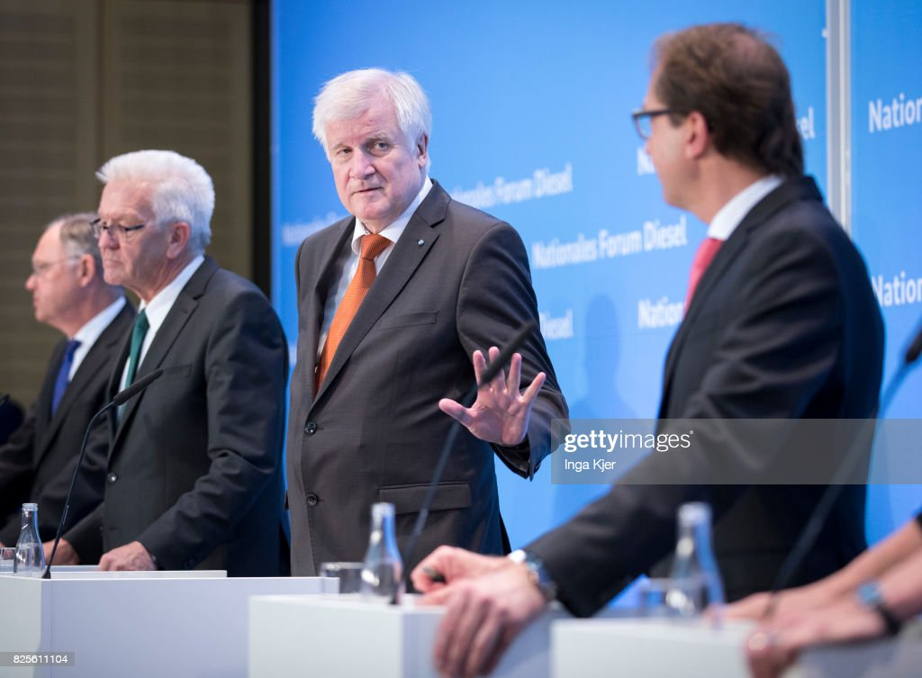 Governor of Lower Saxony Stephan Weil (L-R), Governor of Baden- Wuerttemberg Winfried Kretschmann, Governor of Bavaria Horst Seehofer and German Transport Minister Alexander Dobrindt, attend a press conference in the course of the Diesel Summit on August 02, 2017 in Berlin, Germany. Representatives of the automobile industry and federal politics meet to find solutions in reducing the pollutant emissions of diesel vehicles.