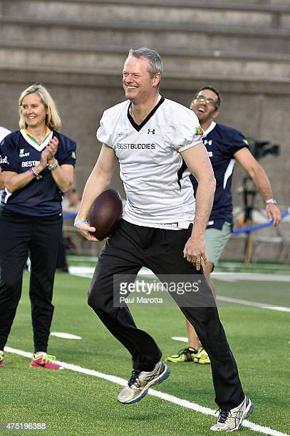 Governor of Massachusetts Charlie Baker participates during the Tom Brady Football Challenge for The Best Buddies Challenge Hyannis Port 2015 at...