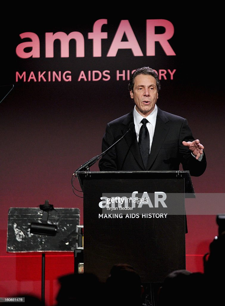Governor of New York Andrew Cuomo speaks onstage at the amfAR New York Gala to kick off Fall 2013 Fashion Week at Cipriani Wall Street on February 6, 2013 in New York City.