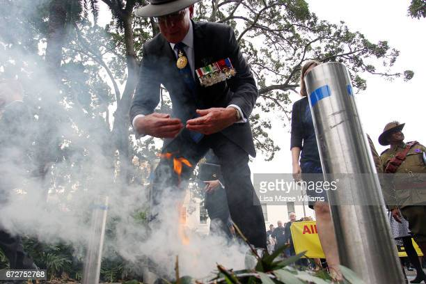 Governor of NSW David Hurley takes part in a traditional smoking ceremony during the ANZAC service at Redfern Park on April 25 2017 in Sydney...