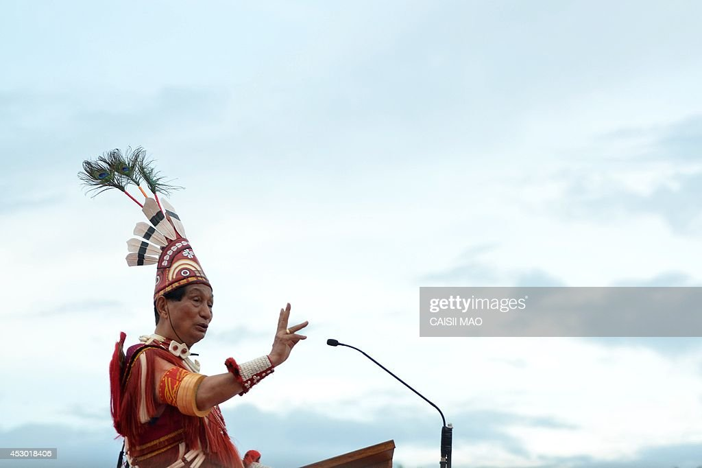 Governor of Orissa and former Chief Minister of Nagaland, Senayangba Chubatoshi Jamir, dressed in Ao traditional attire, speaks during the Ao Naga Tsungremmong festival at Diphupar in Dimapur in the north eastern state of Nagaland on August 1, 2014. The Tsungremmong festival, celebrated by the Ao Nagas, is a thanksgiving festival invoking the blessing of God and an abundant harvest after the completion of seed sowing. AFP PHOTO/ Caisii Mao