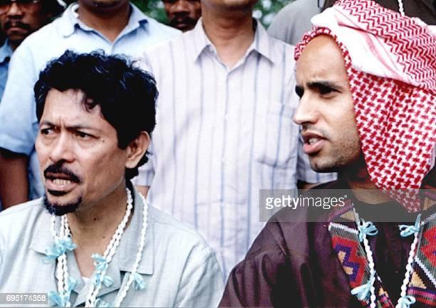 Governor of Philippine Moslem Autonomous Region and former rebel leader Nur Misuari and AlIslam Kadhafi son of Libyan leader Moamer Kadhafi visit...