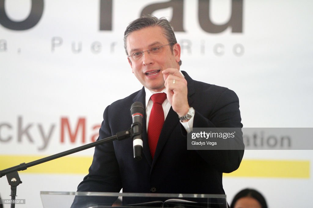 Governor of Puerto Rico Alejandro Garcia Padilla attends the opening of Centro Tau Child Development and Prevention Center on August 25 2014 in Loiza...