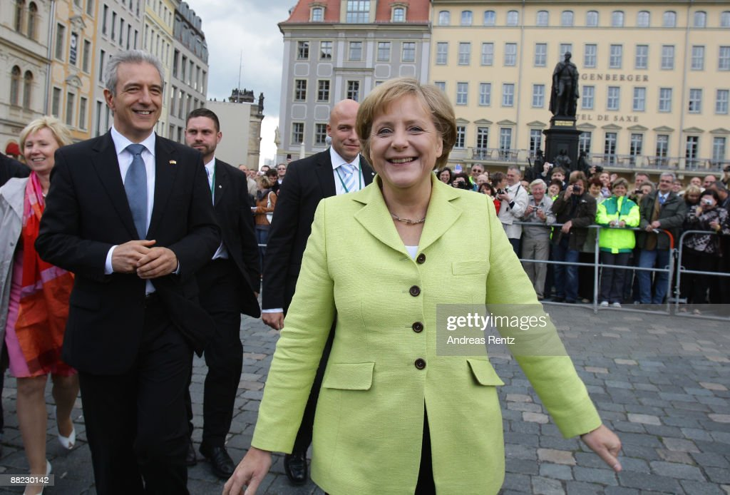Governor of Saxony Stanislaw Tillich (L) and German Chancellor <a gi-track='captionPersonalityLinkClicked' href=/galleries/search?phrase=Angela+Merkel&family=editorial&specificpeople=202161 ng-click='$event.stopPropagation()'>Angela Merkel</a> smile after Merkel and US President Barack Obama toured Dresden's landmark, the Frauenkirche (Church of Our Lady) on June 5, 2009 in Dresden, Germany. After policy talks and a news conference in Dresden, Obama and Merkel are due to travel to Buchenwald, the former Nazi concentration camp where more than 56,000 prisoners died in horrendous conditions.