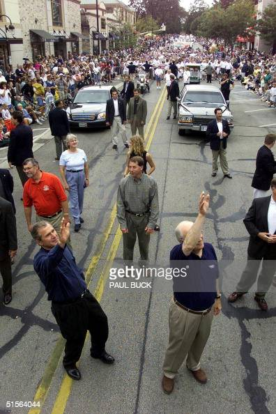 Governor of Texas and Republican presidential candidate George W Bush and running mate Dick Cheney wave to crowds along the parade route in Labor Day...