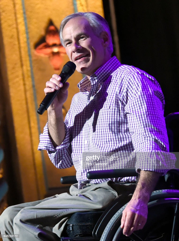 Governor of Texas Greg Abbott performs onstage during George Strait's Hand in Hand Texas benefit concert; Strait and special guests Miranda Lambert, Chris Stapleton, Lyle Lovett and Robert Early Keen perform in concert at the Majestic Theatre on September 12, 2017 in San Antonio, Texas.