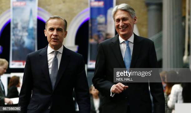 Governor of the Bank of England Mark Carney and Britain's Chancellor of the Exchequer Philip Hammond arrive at the International Fintech Conference...