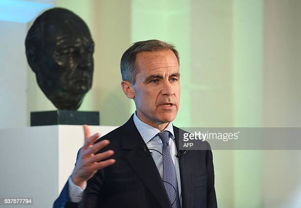 Governor of the Bank of England Mark Carney speaks at the unveiling of the new £5 banknote bearing the image of wartime leader Winston Churchill at...